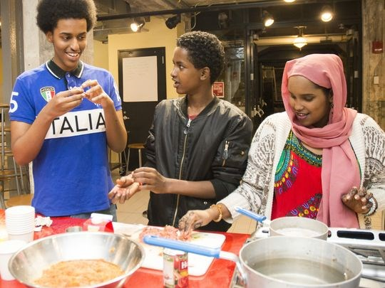 """""""Soo Fariista/Come Sit Down: A Somali American Cookbook"""" features traditional Somali family recipes with a modern Minnesota twist. The cookbook was authored by Somali high school students who participated in the Minnesota Historical Society program """"Wariyaa: Somali Youth in Museums"""" in 2016. Students interviewed family members, collected recipes and stories, researched techniques and ingredients and tested recipes at the Mill City Museum Baking Lab. The """"Somalis + Minnesota"""" exhibit opens June 23, 2018 at the Minnesota History Center. (Photo: Andrea Reed, Minnesota Historical Society)"""