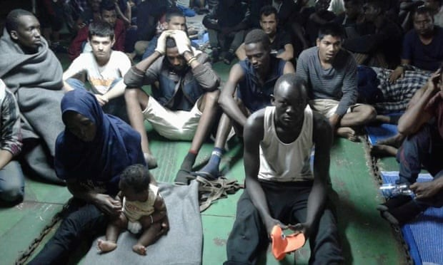 Migrants fleeing Libya refuse to leave ship and be sent back to camps