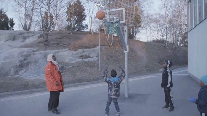 Iman is a keen basketball player and plays with a team set up by the night patrol mothers. [Al Jazeera]
