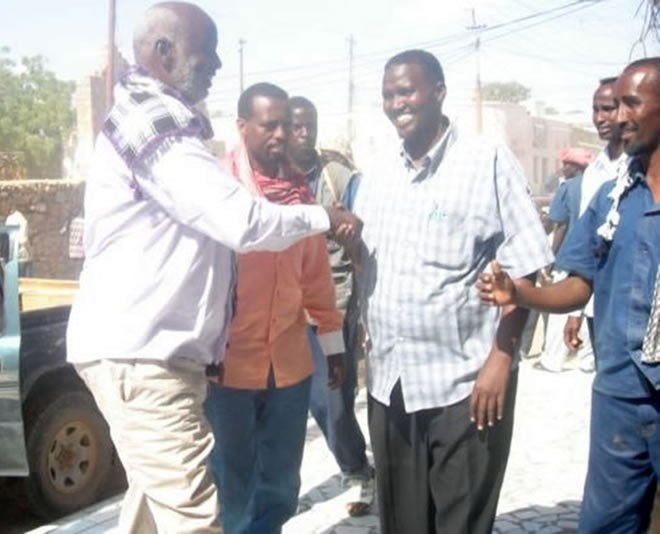 The photo depicts the National Security Minister Omar Hashi Aden, and the Somalia Ambassador to Ethiopia Abdikarim Farah Laqanyo, greeting local representatives in Beledweyne- the last picture before the assassination