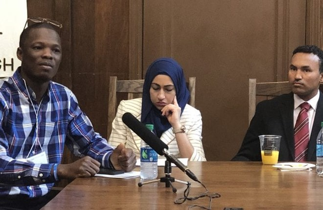 Dauda Sesay, left, along with other former refugees now resettled in the United States, speaks May 8, 2019, at the United Methodist Building in Washington about the need to increase refugee admissions to the United States.