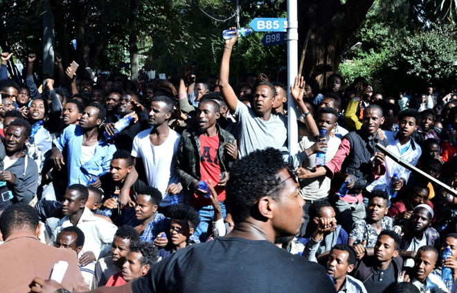 Supporters of Jawar Mohammed, a member of the Oromo ethnic group who has been a critic of Prime Minister Abiy Ahmed, gathered outside his home in Addis Ababa on Thursday after he accused security forces of trying to orchestrate an attack on him © AFP / STRINGER